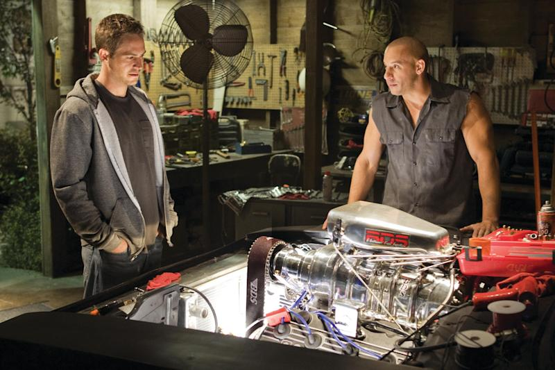 "In this film publicity still released by Universal Pictures, Paul Walker, left, and Vin Diesel, are shown in a scene from ""Fast & Furious."" Universal Pictures has delayed the release of ""Fast & Furious 7"" for almost a year following the death of Paul Walker. The studio announced early Monday, Dec. 23, 2013, that the ""Fast & Furious"" sequel will be released in April 2015, instead of July next year. Shooting on the film was about midway through when the 40-year-old Walker died in a car crash outside of Los Angeles. (AP Photo/Universal Pictures, Jaimie Trueblood)"