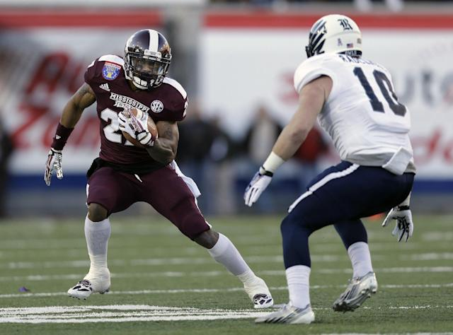 Mississippi State running back LaDarius Perkins, left, tries to get past Rice linebacker James Radcliffe (10) in the second quarter of the Liberty Bowl NCAA college football game on Tuesday, Dec. 31, 2013, in Memphis, Tenn. (AP Photo/Mark Humphrey)