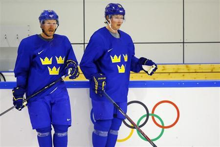 Sweden's Alfredsson and Backstrom participate in a men's ice hockey team practice at the 2014 Sochi Winter Olympics