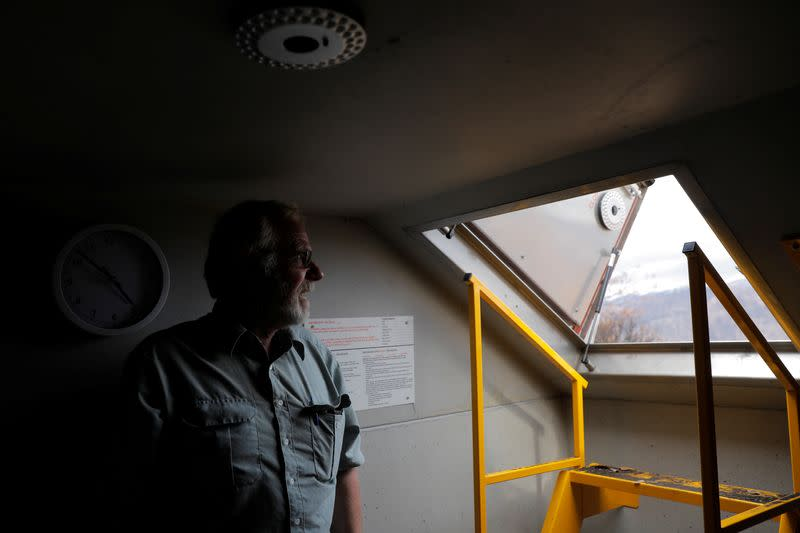Donald Graham, 68, poses in his bunker that he and his wife Bron took shelter in as their home was destroyed by bushfires in Buchan, Victoria, Australia