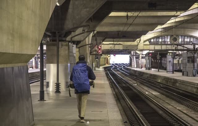 A traveller on an empty platform at at Gare Montparnasse train station in Paris