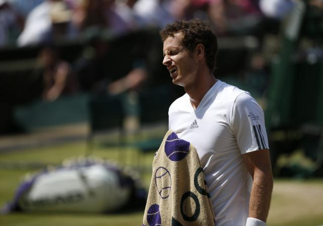 Great Britain's Andy Murray reacts in his Men's Final against Serbia's Novak Djokovic during day thirteen of the Wimbledon Championships at The All England Lawn Tennis and Croquet Club, Wimbledon.