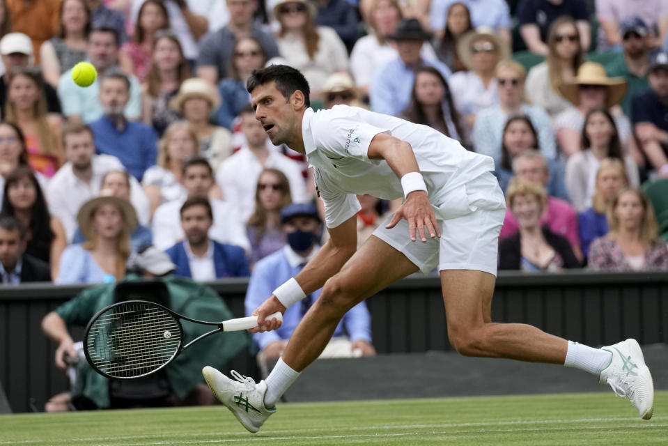 Serbia's Novak Djokovic plays a return to Chile's Cristian Garin during the men's singles fourth round match on day seven of the Wimbledon Tennis Championships in London, Monday, July 5, 2021. (AP Photo/Kirsty Wigglesworth)