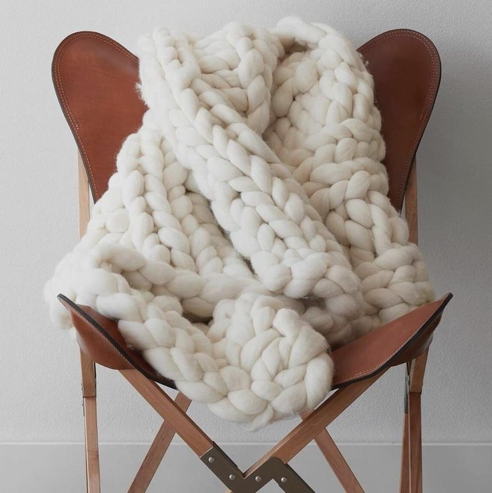 """<p><span>Nublado Wool Throw</span> ($395) </p> <p>""""This throw is so cozy looking and perfect for colder months and naps on the couch. It also looks super chic so you don't have to feel guilty leaving it out and around."""" - LS</p>"""
