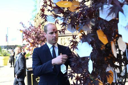 Britain's Prince William leaves a tribute message as he leaves a memorial service on the first anniversary of the Manchester Arena bombing, in Manchester, Britain, May 22, 2018. Paul Ellis/Pool via Reuters