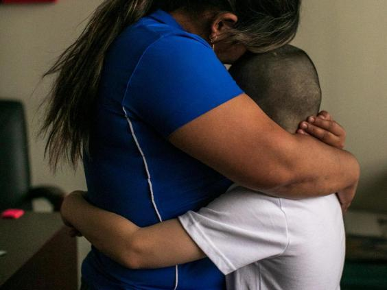 Patricia and her son, Jose, 8, from Honduras, in their lawyer's office in Bryan, Texas (NYT)