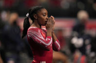 FILE - Simone Biles prepares for the floor exercise during the women's U.S. Olympic Gymnastics Trials in St. Louis, in this Sunday, June 27, 2021, file photo. Biles, the reigning world and Olympic champion, believes the culture within USA Gymnastics is more relaxed now than it was under former national team coordinator Martha Karolyi, maybe too relaxed. (AP Photo/Jeff Roberson, File)