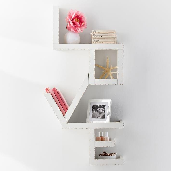 "<p>Give them a place to put all their tchotchkes with this <a rel=""nofollow noopener"" href=""https://www.popsugar.com/buy/Love%20Shelf-366337?p_name=Love%20Shelf&retailer=pbteen.com&price=139&evar1=moms%3Aus&evar9=45367395&evar98=https%3A%2F%2Fwww.popsugar.com%2Fmoms%2Fphoto-gallery%2F45367395%2Fimage%2F45367429%2FLove-Shelf&list1=holiday%2Cgift%20guide%2Cparenting%20gift%20guide%2Cgifts%20for%20kids%2Ckid%20shopping%2Ctweens%20and%20teens%2Cgifts%20for%20teens&prop13=desktop&pdata=1"" target=""_blank"" data-ylk=""slk:Love Shelf"" class=""link rapid-noclick-resp"">Love Shelf</a> ($139).</p>"