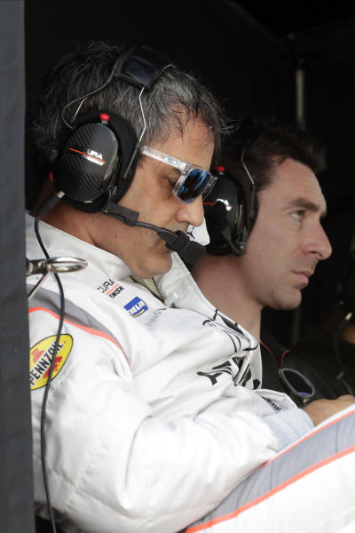 FILE - In this Jan. 3, 2020 file photo, Juan Pablo Montoya, left, and Simon Pagenaud watch teammate Dane Cameron on the track during testing for the upcoming Rolex 24 hour auto race at Daytona International Speedway in Daytona Beach, Fla. The Rolex 24 begins Saturday, Jan. 25.(AP Photo/John Raoux, File)