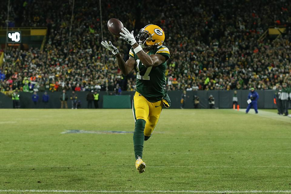 GREEN BAY, WISCONSIN - JANUARY 12: Davante Adams #17 of the Green Bay Packers makes a touchdown catch against the Seattle Seahawks in the first quarter of the NFC Divisional Playoff game at Lambeau Field on January 12, 2020 in Green Bay, Wisconsin. (Photo by Dylan Buell/Getty Images)
