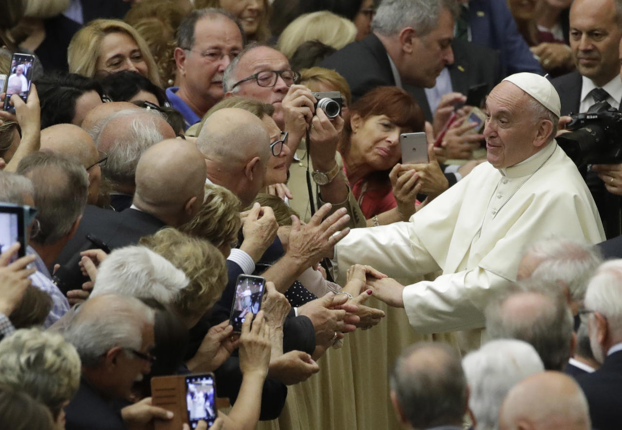 <p> Pope Francis greets members of an association of people honored by the Italian Presidency for their commitment to their work, in the Paul VI Hall at the Vatican, Friday, June 15, 2018. (AP Photo/Alessandra Tarantino) </p>
