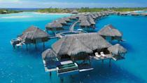 """Here's a riddle for you: What's better than doing nothing at all? Doing nothing at all in Bora Bora. Whether you're a honeymooner or a parent in need of a break, this <a href=""""https://www.cntraveler.com/story/island-hopping-in-french-polynesia?mbid=synd_yahoo_rss"""" rel=""""nofollow noopener"""" target=""""_blank"""" data-ylk=""""slk:French Polynesian"""" class=""""link rapid-noclick-resp"""">French Polynesian</a> paradise feels worlds away from the minutiae of the everyday; and with little but miles of crystalline waters in sight, you and your partner will have almost nothing to distract you from one another. At this luxe Four Seasons outpost, there are several multi-bedroom beachfront villas and overwater bungalow suites (with either lagoon or mountain views) to choose from. But for the full experience, we'd suggest booking one of the specialty overwater bungalow suites; these one-bedroom set-ups offer nearly 1,600 square feet of space to move around, plus a deck that runs the length of your bungalow or a private plunge pool. To really up the romantic ante, book a couples' treatment at the overwater spa suite; beds sit above glass panels on the lagoon, while the outdoor tub has views of nearby Mount Otemanu."""