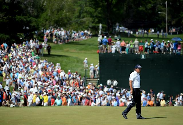 ARDMORE, PA - JUNE 15: Phil Mickelson of the United States walks across the third green during Round Three of the 113th U.S. Open at Merion Golf Club on June 15, 2013 in Ardmore, Pennsylvania. (Photo by Ross Kinnaird/Getty Images)