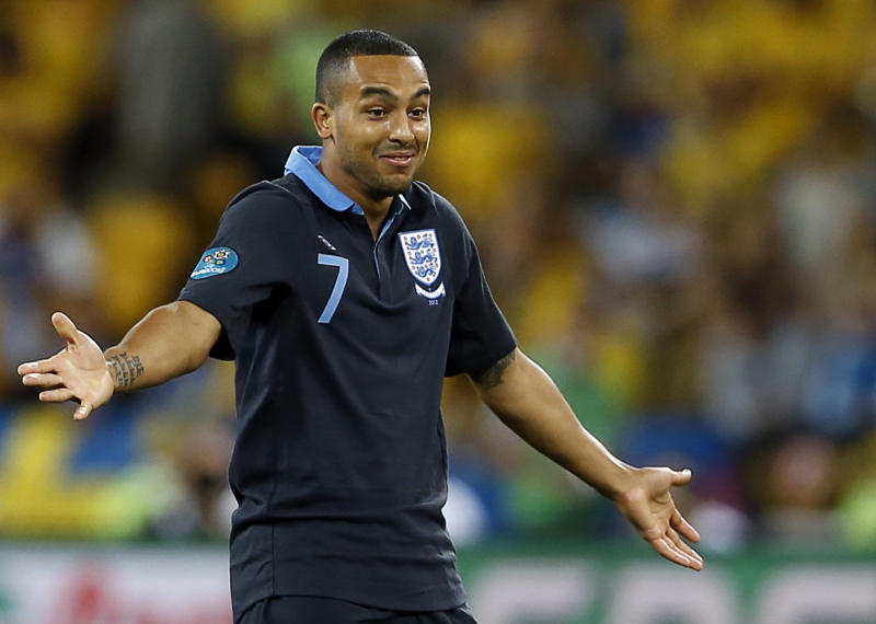 England's Theo Walcott celebrates after scoring during the Euro 2012 soccer championship Group D match between Sweden and England in Kiev, Ukraine, Friday, June 15, 2012. (AP Photo/Kirsty Wigglesworth)
