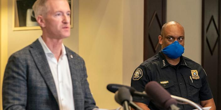 "Portland Police Chief Chuck Lovell looks at Mayor Ted Wheeler during a press conference on August 30, 2020. <p class=""copyright""><a href=""https://www.gettyimages.com/detail/news-photo/chuck-lovell-portland-police-bureau-chief-listens-to-news-photo/1228276696?adppopup=true"" rel=""nofollow noopener"" target=""_blank"" data-ylk=""slk:Nathan Howard/Getty"" class=""link rapid-noclick-resp"">Nathan Howard/Getty</a></p>"