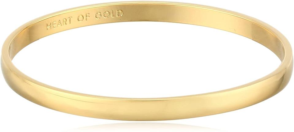 """<h3>kate spade new york Heart Of Gold Bangle</h3><br>Jewelry is always a good idea. This timeless bangle with a hidden engraving (only you and your recipient will know it's there) is a sure-to-delight luxe gift that clocks in at under $50.<br><br><strong>kate spade new york</strong> Heart Of Gold Bangle, $, available at <a href=""""https://amzn.to/35Fc7uW"""" rel=""""nofollow noopener"""" target=""""_blank"""" data-ylk=""""slk:Amazon"""" class=""""link rapid-noclick-resp"""">Amazon</a>"""