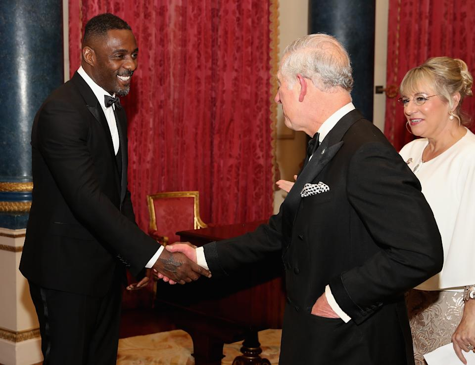 LONDON, ENGLAND - DECEMBER 14:  Prince Charles, Prince of Wales chats to actor Idris Elba  as he hosts the 'One Million Young Lives' dinner at Buckingham Palace on December 14, 2017 in London, England.  (Photo by Chris Jackson/Getty Images)