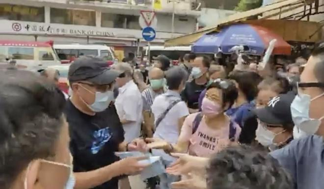 Activist Tam Tak-chi set up street booths across Hong Kong in June and August, where he gave out face masks and criticised the government. Photo: Facebook