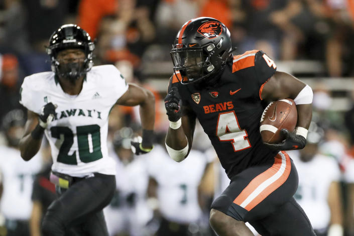 Oregon State running back B.J. Baylor (4) scores a touchdown off of a 30-yard rush during the second half of an NCAA college football game against Hawaii, Saturday, Sept. 11, 2021, in Corvallis, Ore. Oregon State won 45-27. (AP Photo/Amanda Loman)