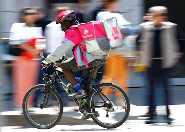 A food delivery driver for Foodora cycles in downtown Milan, Italy, May 18, 2018. REUTERS/Stefano Rellandini