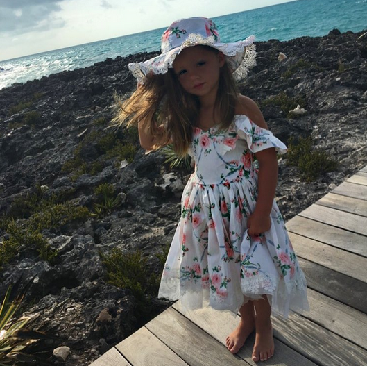 """<p>""""I just can't take it,"""" Kim wrote beside a beautiful shot of her 3-year-old daughter Kaia wearing a floral dress with a matching hat. She doesn't appear to be having as much fun posing as her mom is taking the pic, however. (Photo: <a href=""""https://www.instagram.com/p/BVCeXO6hwcA/"""" rel=""""nofollow noopener"""" target=""""_blank"""" data-ylk=""""slk:Kim Zolciak-Biermann via Instagram"""" class=""""link rapid-noclick-resp"""">Kim Zolciak-Biermann via Instagram</a>) </p>"""