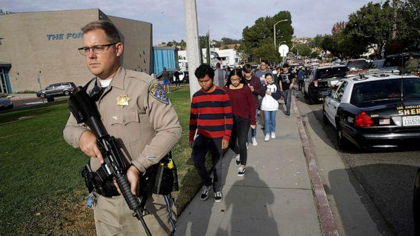 PHOTO: Students are escorted out of Saugus High School after reports of a shooting on Nov. 14, 2019, in Santa Clarita, Calif. (Marcio Jose Sanchez/AP)