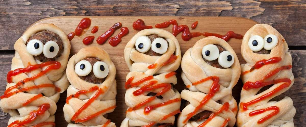<cite>GreenArt/Shutterstock</cite> <br>Homemade sausage and meatball mummies wrapped in dough, baked and covered with fake blood a.k.a. ketchup.<br>