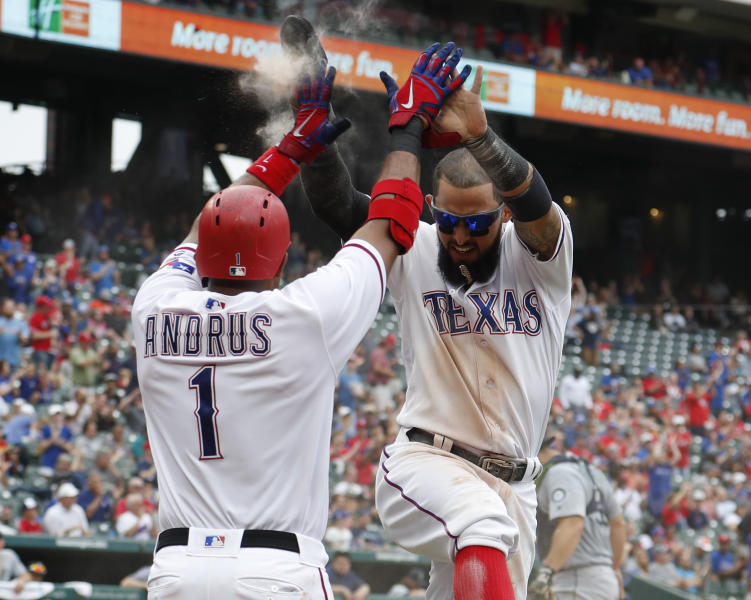 Texas Rangers' Elvis Andrus (1) and Rougned Odor, right, celebrate their runs scored on a double by Nomar Mazara against the Seattle Mariners during the sixth inning of a baseball game, Sunday, Sept. 23, 2018, in Arlington, Texas. (AP Photo/Jim Cowsert)