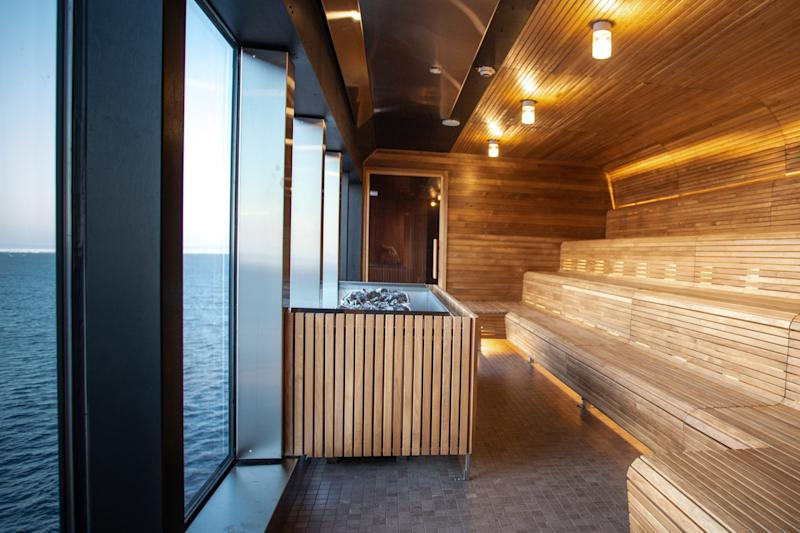 A sea-view sauna onboard Hurtigruten's MS Roald Amundsen, which features countless sustainable materials and is partly powered by organic waste matter.