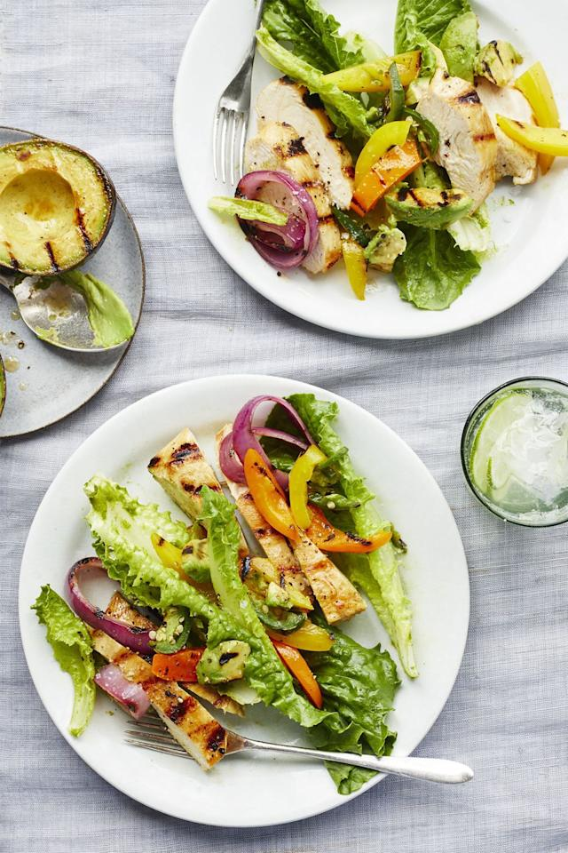 """<p>Mix up your summer salads by grilling your avocados, which will add a smoky flavor to this buttery fruit. </p><p><strong><a rel=""""nofollow"""" href=""""https://www.womansday.com/food-recipes/food-drinks/recipes/a59406/chicken-fajita-salad-lime-cilantro-vinaigrette-recipe/"""">Get the recipe.</a></strong></p>"""