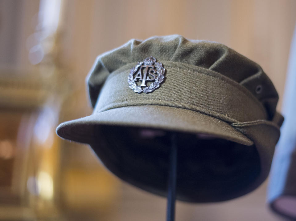 Embargoed to 2100 Friday May 08 File photo dated 04/07/16 of an Auxiliary Territorial Service cap, worn by Princess Elizabeth whilst serving in the wartime ATS, on display at Buckingham Palace in London. The Queen was surrounded by historic personal mementos from the war years as she addressed the nation on the 75th anniversary of VE Day.