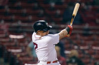 Boston Red Sox's Christian Vazquez follows through on his RBI double during the sixth inning of a baseball game against the Detroit Tigers at Fenway Park, Tuesday, May 4, 2021, in Boston. (AP Photo/Charles Krupa)