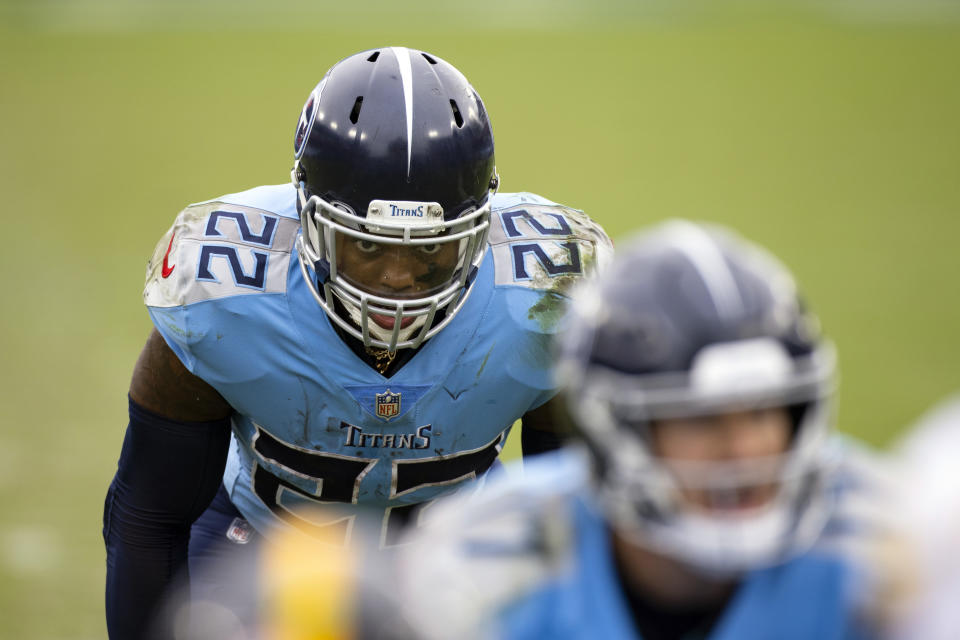 FILE - In this Oct. 25, 2020, file photo, Tennessee Titans running back Derrick Henry (22) lines up in the backfield during the second half of an NFL football game against the Pittsburgh Steelers in Nashville, Tenn. Fresh off becoming just the eighth man to run for at least 2,000 yards, Henry now has a 17th game giving him a chance at Eric Dickerson's league record of 2,105 yards set in 1984. (AP Photo/Brett Carlsen, File)
