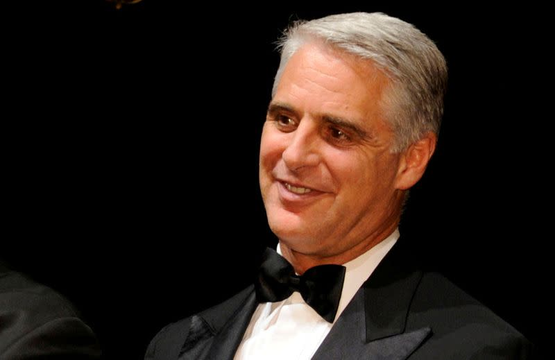 FILE PHOTO: Andrea Orcel poses with an award at the 2016 IFR Awards event in London