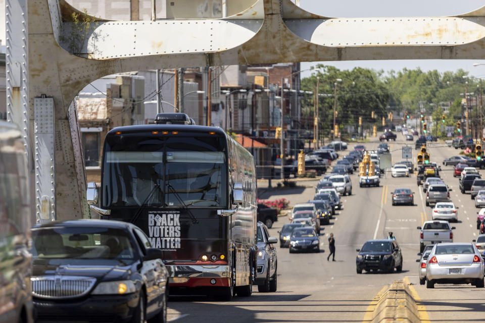 """The Black Voters Matter bus leads a """"votercade"""" -- a motorcade of voters -- across the Edmund Pettus Bridge, Saturday, May 8, 2021, in Selma, Ala. The group was moving between events in the John Lewis Advancement Act Day of Action, a voter education and engagement event held in Selma and Montgomery. (AP Photo/Vasha Hunt)"""