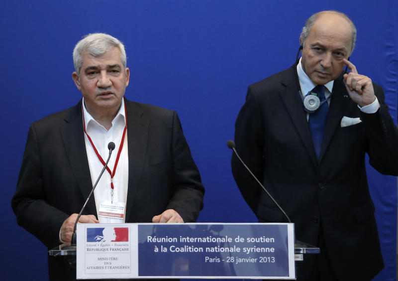 French Foreign Affairs Minister Laurent Fabius, right, listens to Syrian National Coalition vice-president Riad Seif during a press conference at the International support meeting of the Syrian National Coalition in Paris, Monday, Jan. 28, 2013. France has called together representatives of some 50 nations to coax them to make good on promises to help the Syrian opposition coalition, in need of funds to move forward in its bid to oust the regime of Bashar Assad. (AP Photo/Francois Mori)