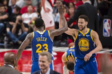 May 20, 2019; Portland, OR, USA; Golden State Warriors guard Klay Thompson (11) celebrates with forward Draymond Green (23) after Green scored a three-point basket in overtime against the Portland Trail Blazers in game four of the Western conference finals of the 2019 NBA Playoffs at Moda Center. The Warriors won 119-117 in overtime. Mandatory Credit: Troy Wayrynen-USA TODAY Sports