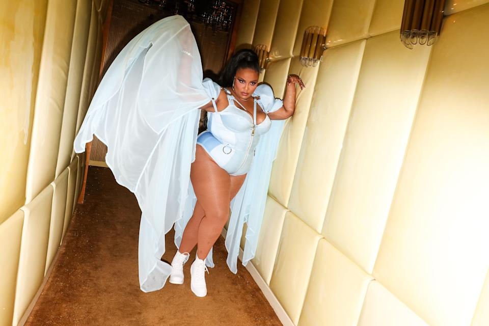 The party doesn't just stop on the red carpet. Lizzo partied in style at the Met Gala afterparty in a pale blue bodysuit, a matching sheer scarf, and, again, her white Docs.