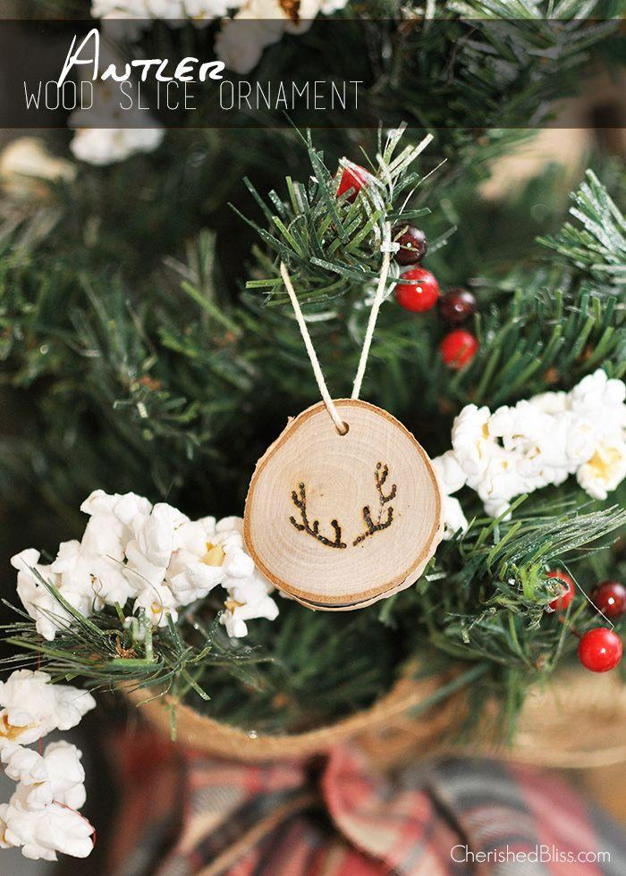 """<p>Going for a natural vibe this year? Craft these cute wood slice ornaments with tiny antlers burned into them. They almost look store-bought!</p><p>Get the tutorial at <a href=""""https://cherishedbliss.com/antler-wood-slice-ornaments/"""" rel=""""nofollow noopener"""" target=""""_blank"""" data-ylk=""""slk:Cherished Bliss"""" class=""""link rapid-noclick-resp"""">Cherished Bliss</a>.</p>"""