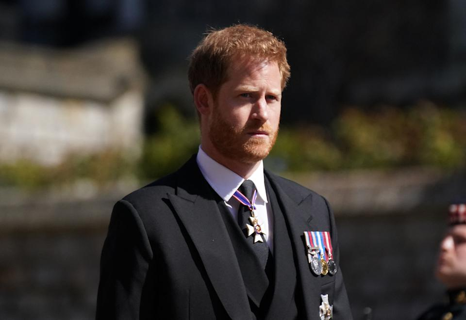 Prince Harry, Duke of Sussex walks during the funeral procession of Britain's Prince Philip