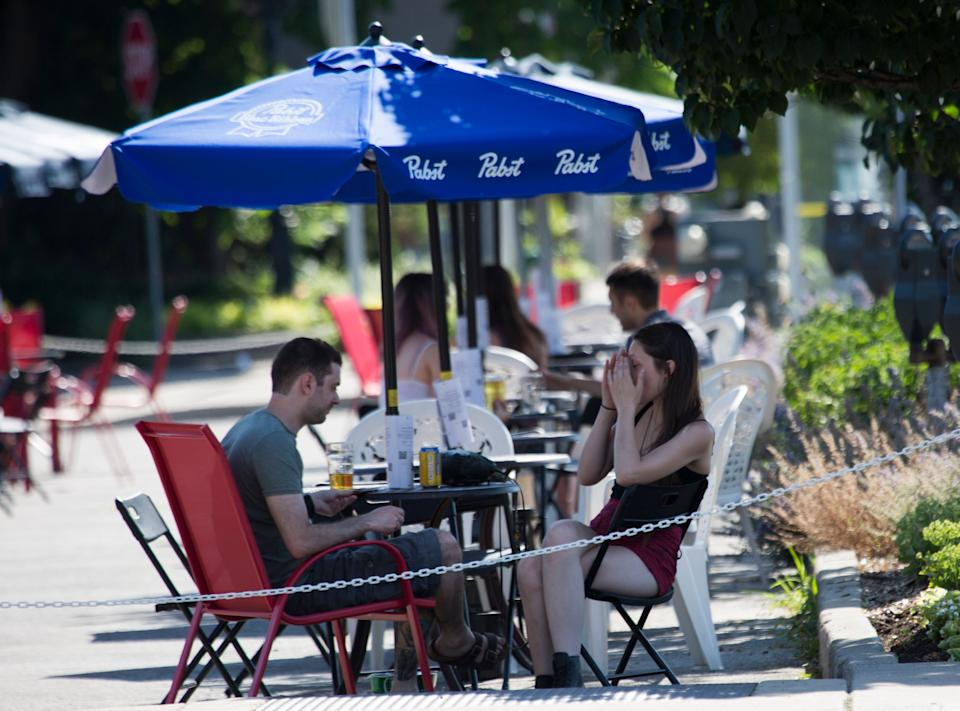 Restaurants, bars and other food and drink establishments are open for dining in outdoor areas, like patios, curbside, parking lots and adjacent properties in the places of Ontario cleared to enter Phase 2 of reopening amid the COVID-19 pandemic in Hamilton, Ont. on July 7, 2020. (Photo: NurPhoto via Getty Images)
