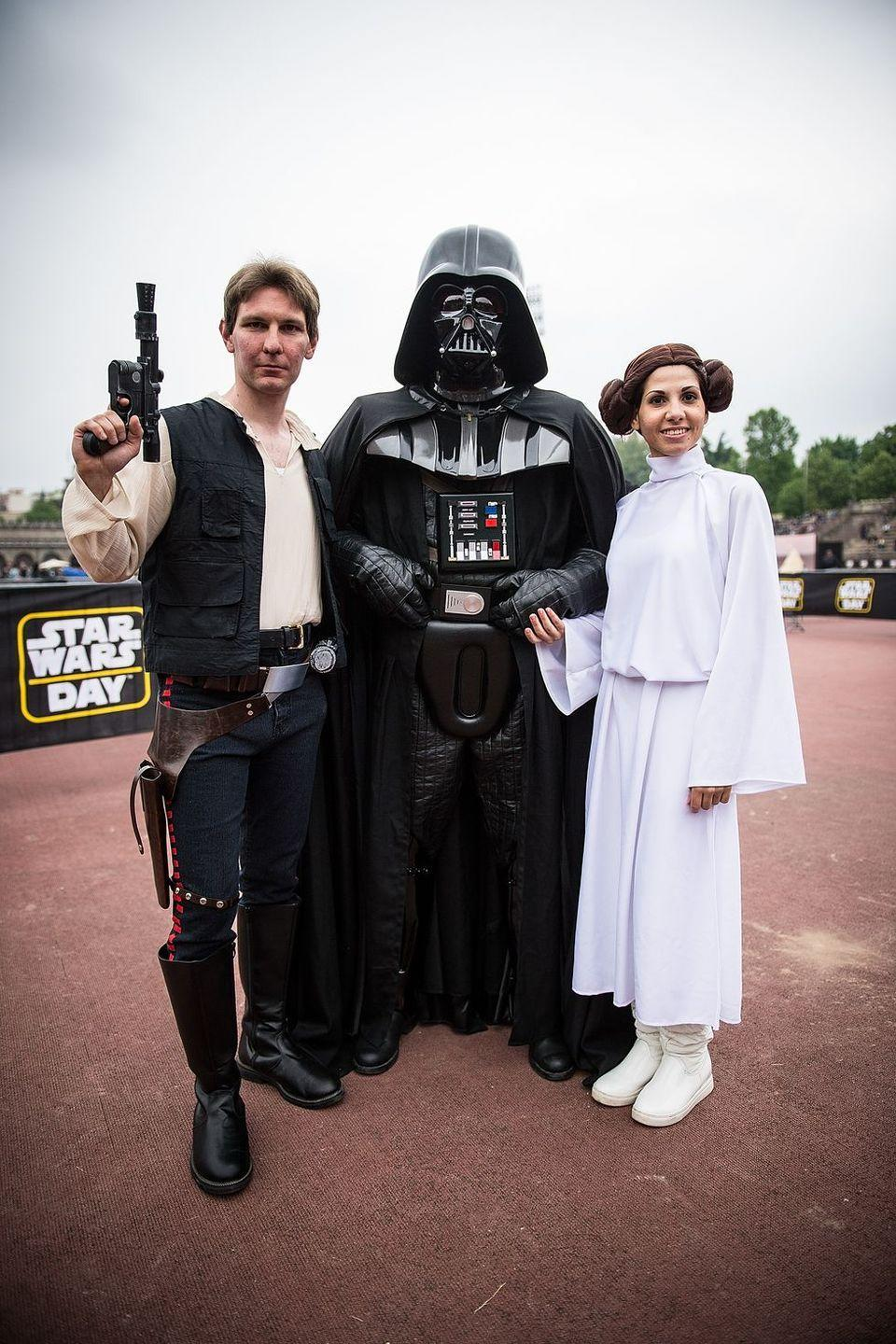 """<p><a href=""""https://www.womansday.com/style/g28692510/star-wars-costume-ideas/"""" rel=""""nofollow noopener"""" target=""""_blank"""" data-ylk=""""slk:Stars Wars costumes"""" class=""""link rapid-noclick-resp""""><em>Stars Wars</em> costumes</a> never go out of style, and the force will definitely be with your group if you take on Hans Solo, Darth Vader, and Princess Leia this year.</p><p><a class=""""link rapid-noclick-resp"""" href=""""https://www.amazon.com/Rubies-Star-Darth-Vader-Molded/dp/B0009S6TJ4?tag=syn-yahoo-20&ascsubtag=%5Bartid%7C10070.g.23122163%5Bsrc%7Cyahoo-us"""" rel=""""nofollow noopener"""" target=""""_blank"""" data-ylk=""""slk:SHOP DARTH VADER MASK"""">SHOP DARTH VADER MASK</a></p>"""