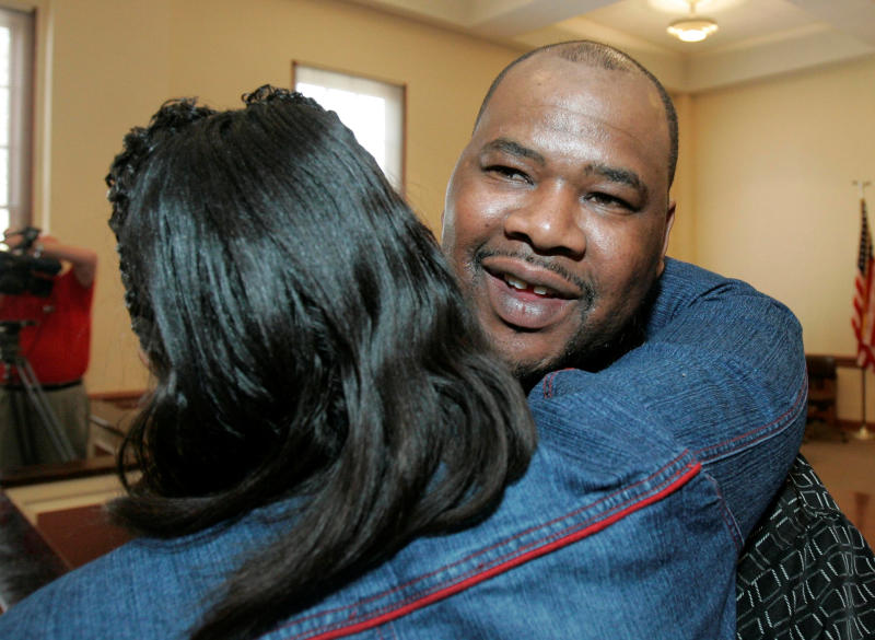 FILE-In this Friday, Feb. 15, 2008 file photo shows Kennedy Brewer, right, hugged by a friend, moments after a circuit court judge exonerated him for the kidnapping and murder of a 3-year-old girl in Macon, Miss. Convicted in 1995 of raping and killing his girlfriend's 3-year-old daughter and sentenced to death. In 2001, DNA testing proved that Brewer was innocent. Since 2000, at least 18 men convicted in rapes and murders largely because of bite-mark analysis have been exonerated by DNA testing or otherwise proved not guilty. (AP Photo/Rogelio V. Solis, File)