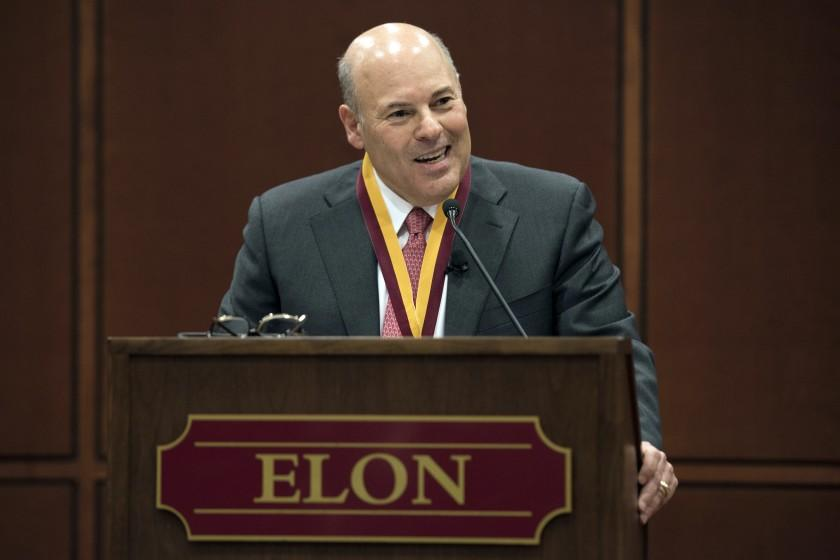 """FILE - In this March 1, 2017, file photo, Elon Trustee Louis DeJoy is honored with Elon's Medal for Entrepreneurial Leadership in Elon. N.C. Mail deliveries could be delayed by a day or more under cost-cutting efforts being imposed by the new postmaster general, DeJoy. The plan eliminates overtime for hundreds of thousands of postal workers and says employees must adopt a """" different mindset"""" to ensure the Postal Service's survival during the coronavius pandemic. (Kim Walker/Elon University via AP, File)"""