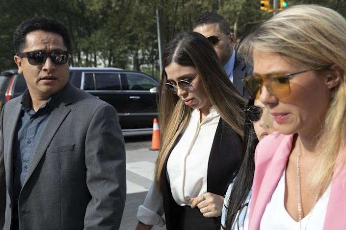 """FILE - In this July 17, 2019 file photo, Emma Coronel Aispuro, center, wife of Mexican drug lord Joaquin """"El Chapo"""" Guzman, arrives for his sentencing at Brooklyn federal court, in New York. According to the United States Department of Justice, Coronel has been arrested on Monday, Feb. 22, 2021, under drug trafficking charges. (AP Photo/Mark Lennihan, File)"""