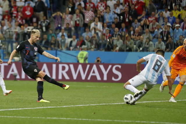 Croatia's Ivan Rakitic, left, shoots the ball to score his side's third goal during the group D match between Argentina and Croatia at the 2018 soccer World Cup in Nizhny Novgorod Stadium in Nizhny Novgorod, Russia, Thursday, June 21, 2018. Rakitic scored once in Croatia's 3-0 victory. (AP Photo/Ricardo Mazalan)