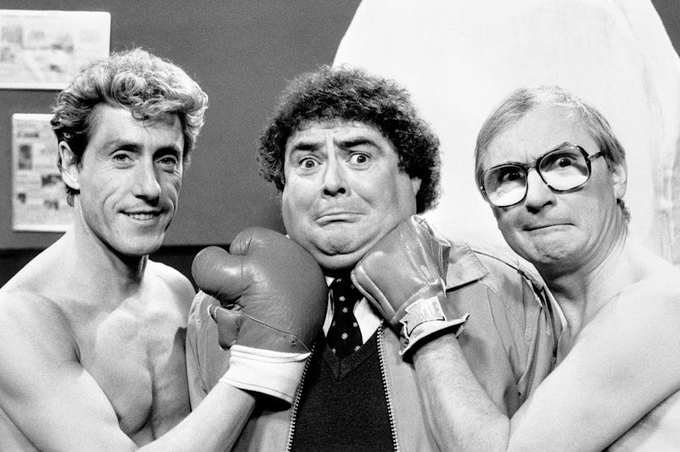 Lead singer of The Who, Roger Daltrey pulling a punch on Eddie Large with the help of Syd Little.  The last in the present series of the 'Little and Large' show will be aired on April 5th