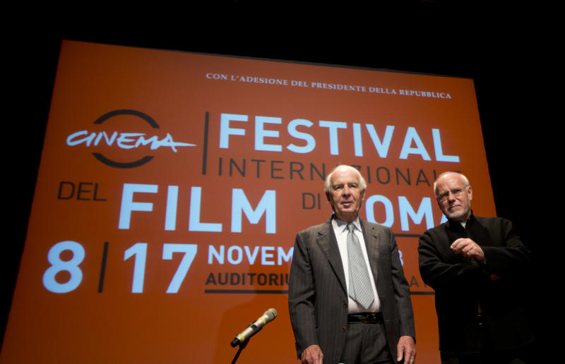 """Paolo Ferrari, President of """"Fondazione Cinema per Roma"""", left, and Rome Film Festival artistic director Marco Muller pose for photographers before they present the 8th edition of the Rome Film Festival at Rome's auditorium, Monday, Oct. 14, 2013. The Festival opens on Nov. 8 and will go on until Nov. 17. (AP Photo/Alessandra Tarantino)"""