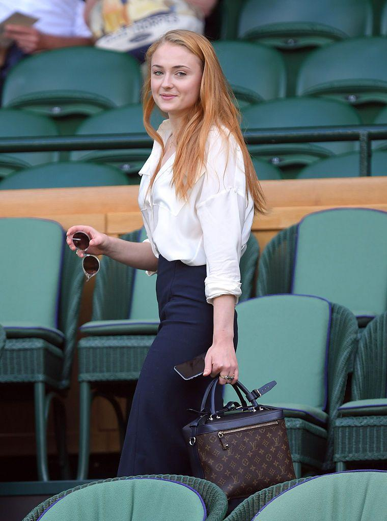 <p>Turner wore a pair of high-waisted trousers with a Louis Vuitton bag for Wimbledon. </p>