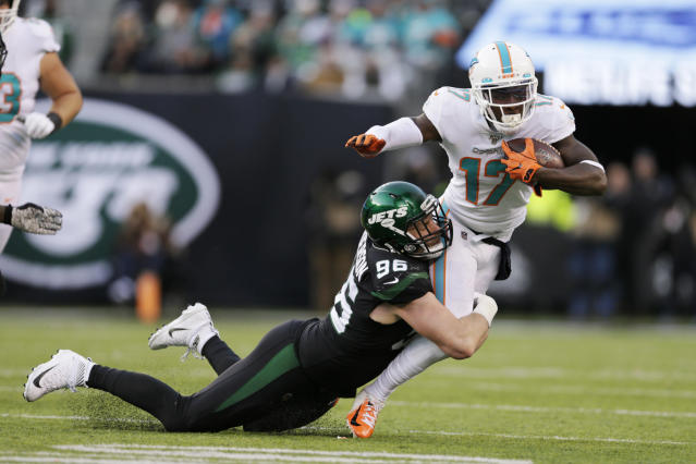 New York Jets defensive end Henry Anderson (96) tackles Miami Dolphins wide receiver Allen Hurns (17) during the second half of an NFL football game, Sunday, Dec. 8, 2019, in East Rutherford, N.J. (AP Photo/Adam Hunger)